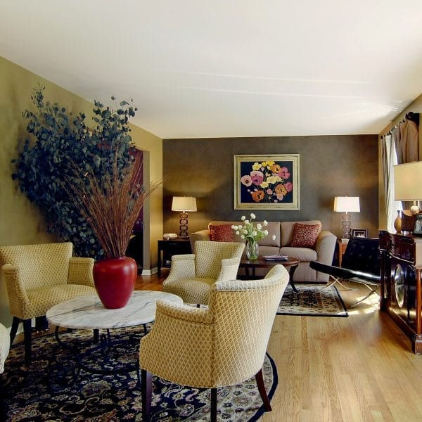 Separate conversation areas in the Living Room create a social atmosphere in the Interior Design Plan.