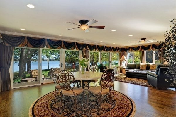 Home furnishings carefully chosen to showcase the water front views in this Lake Barrington home
