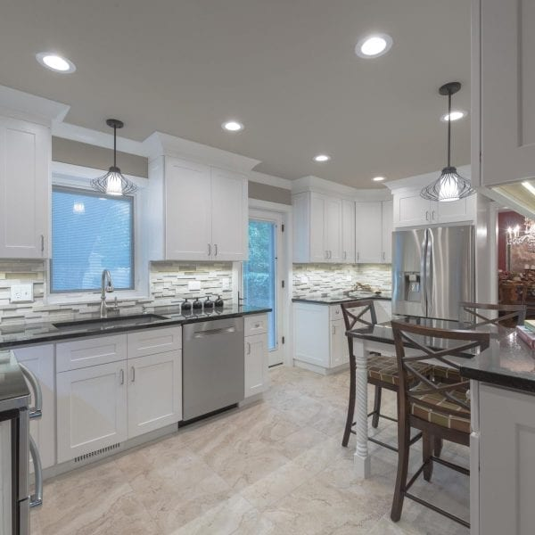 The three dimensional back splash pops in this beautiful white kitchen design. Palatine Illinois kitchen design and kitchen remodel.