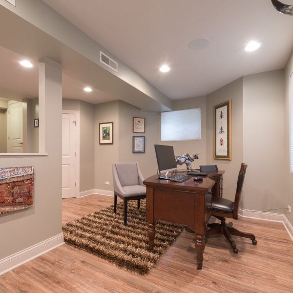 The basement remodel in this Geneva, IL residence includes a clean, efficient office space.